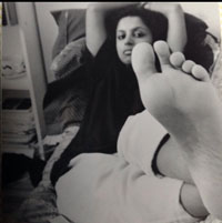 Author Photo of Devi S. Laskar lying on bed