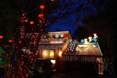 CHRISTMAS LIGHTS IN A TOWN WITH A POPULATION OF 500 by Neil Boyack