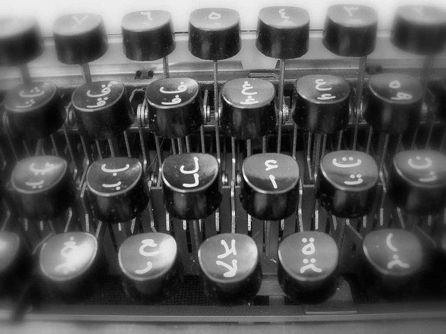 close-up of typewriter keys with arabic alphabet
