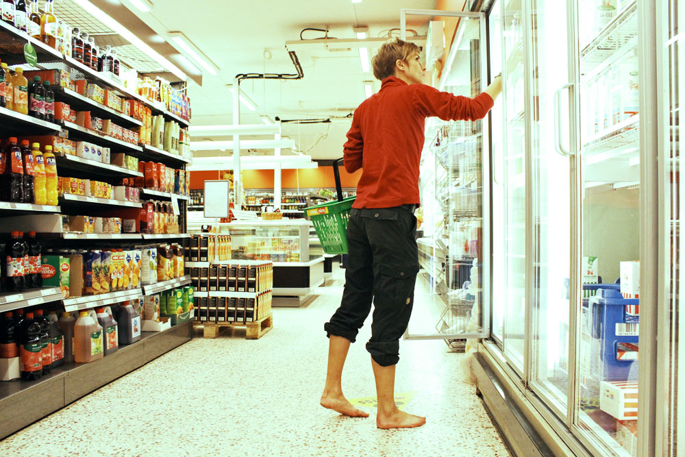 Woman in supermarket with bare feet