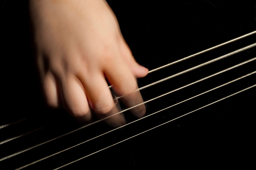 Hand on instrument strings