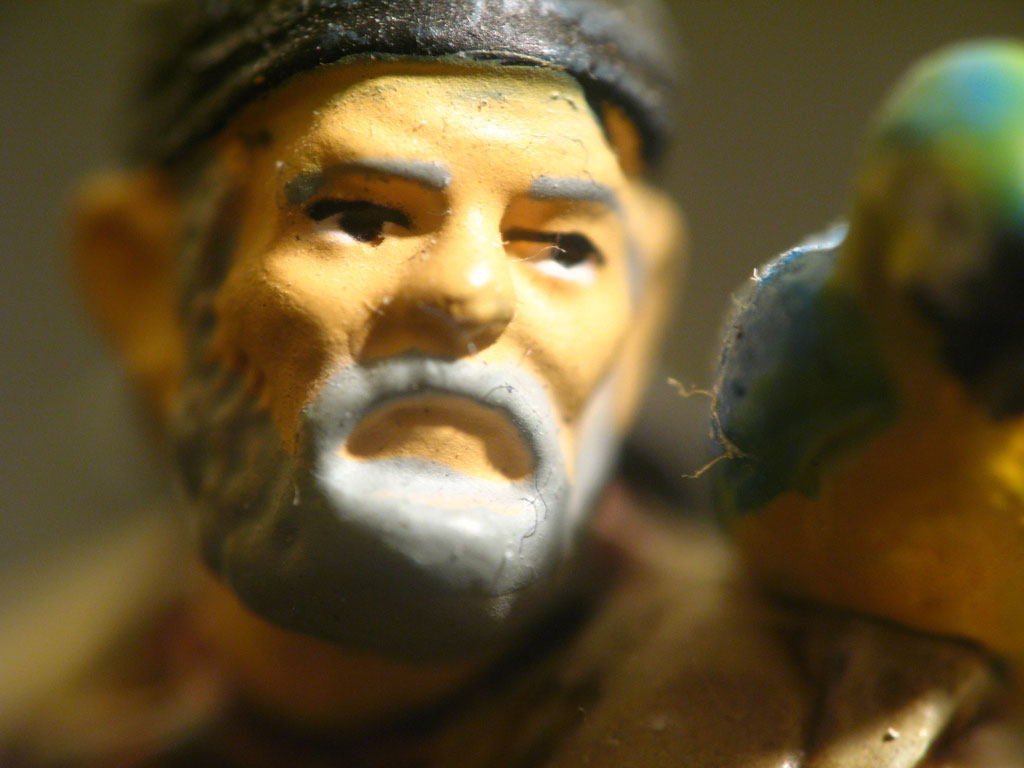 Ceramic figure of a man with a beard wearing a hat