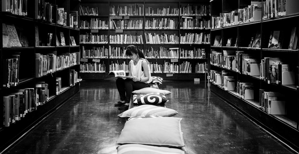 Black and white woman in bookstore