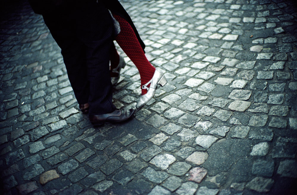 Cobblestone street with woman's heels and man's loafers