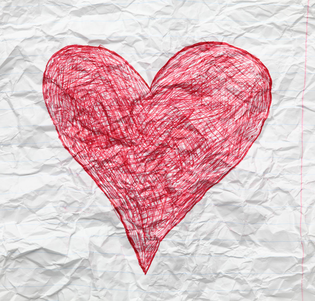 Crumpled paper with scribbled pink heart