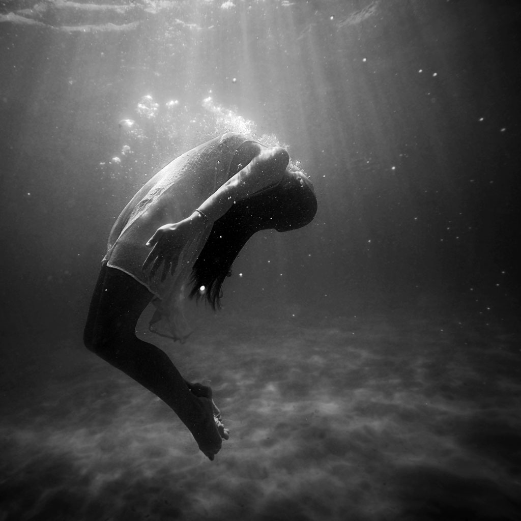 Black and white woman underwater