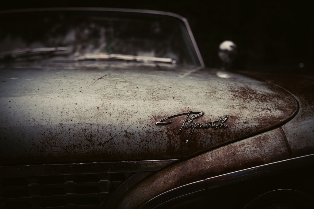 Old rusted Plymouth car