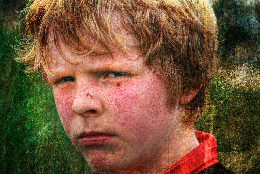 Close-up of boy with red hair and freckles