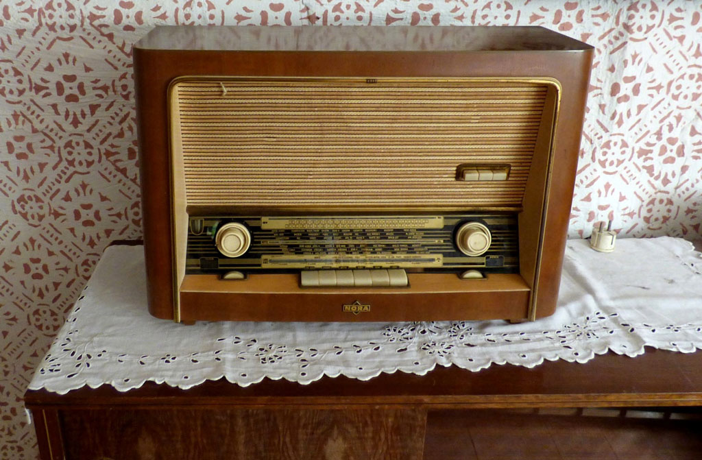 Old radio on lace doily