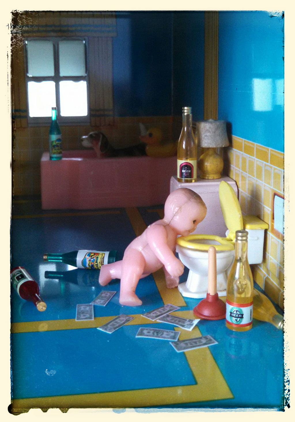 plastic toy baby in dollhouse bathroom