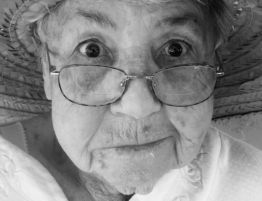 Black and white photo of elderly woman with glasses