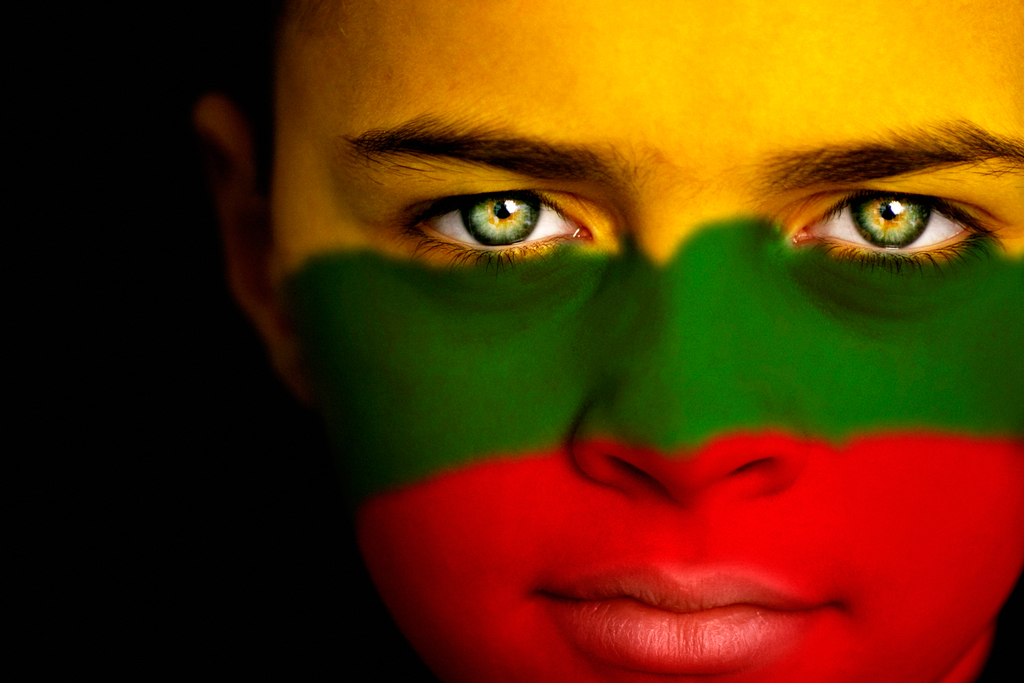 Girl with the colors of the Lithuanian flag painted across her face