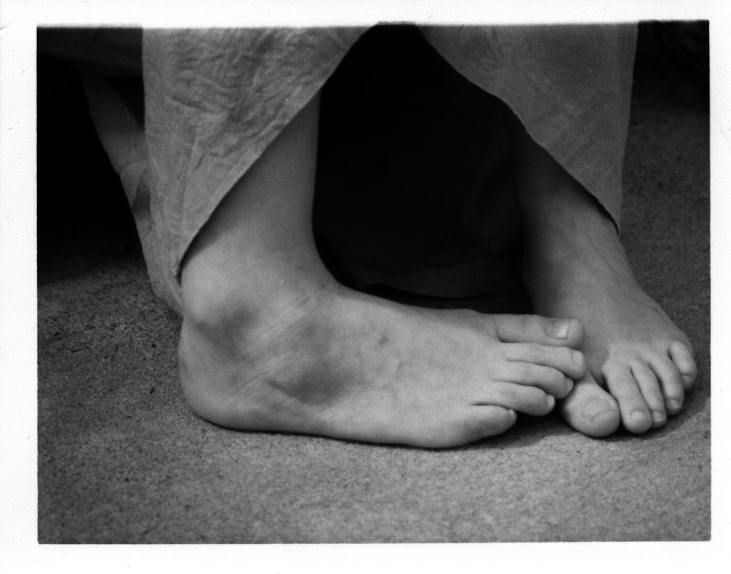 Bare feet on a conrete floor