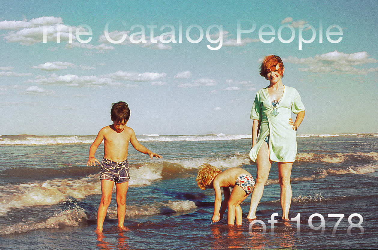 A woman standing next to two children dipping their toes in the ocean, with the title of the piece faded into the borders