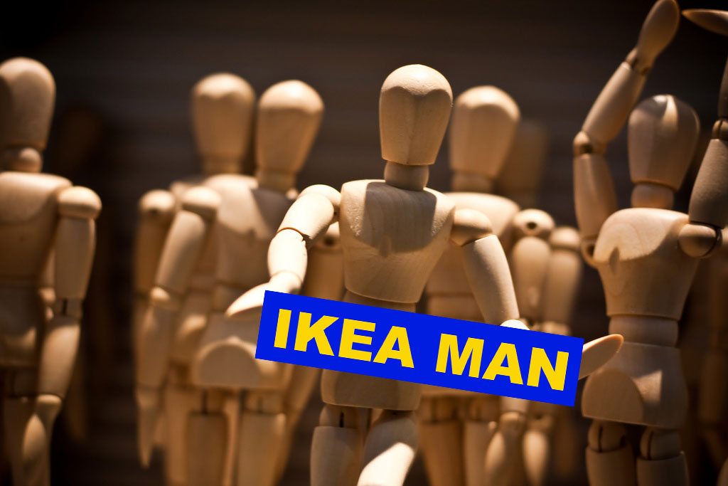 "Wood mannequins with title ""Ikea Man"""