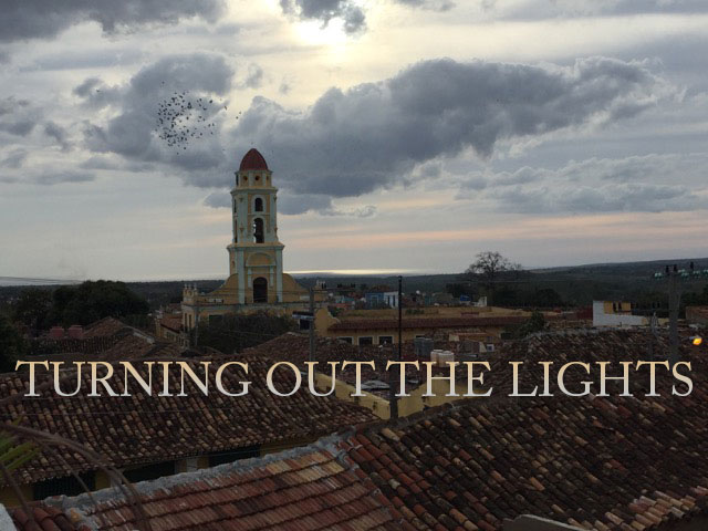 spire against clouded sky with text saying 'turning out the lights'