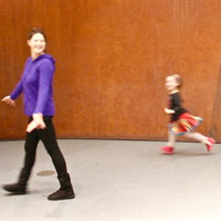 Lucy Anderson walking across a room with her daughter
