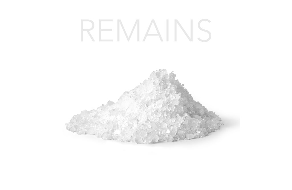 "Mound of salt with title ""Remains"""