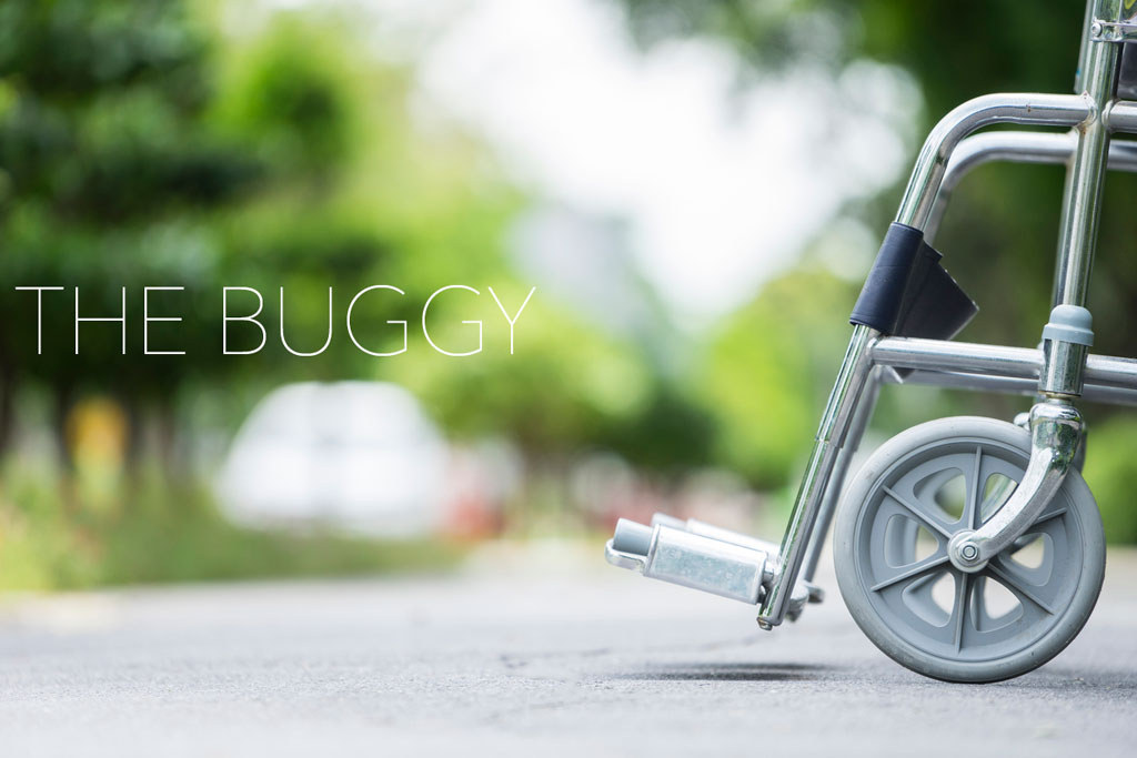 "Close detail of a wheelchair with title ""The Buggy"""