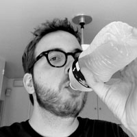 Eric Andrew Newman drinking from a water bottle