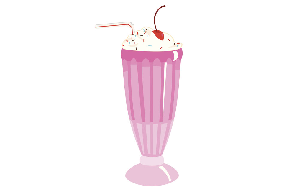 Milkshake with whipped cream and cherry in pink cup