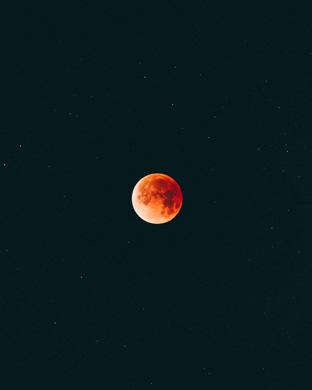 Night sky with red moon