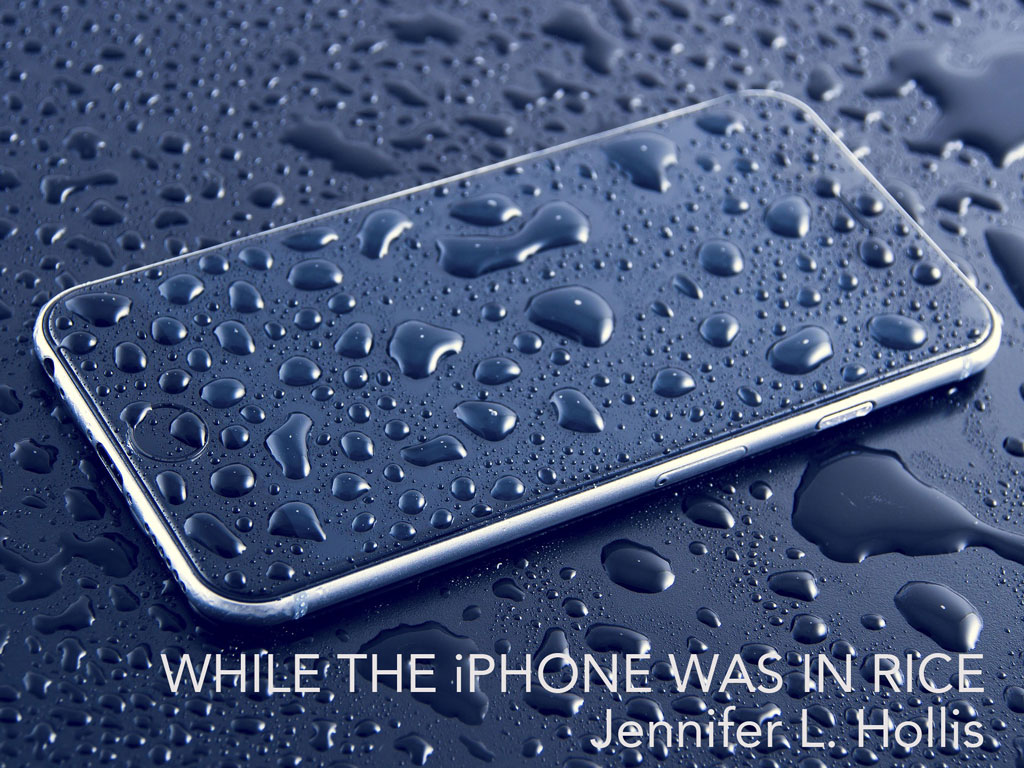 iPhone on a wet surface, covered in drops of water, with the title of the piece on the bottom of the photo