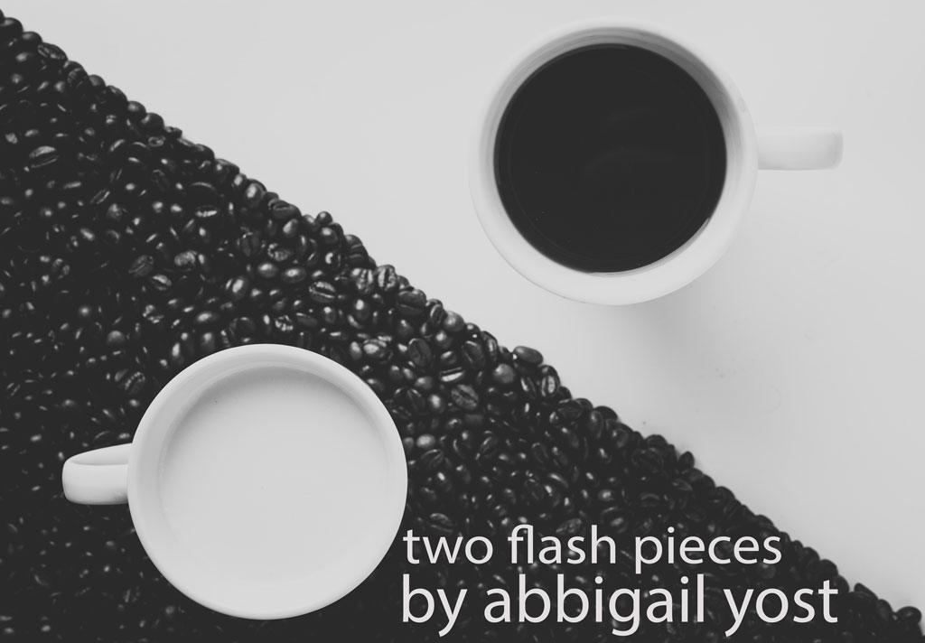 Two mugs on a table, one filled with milk and one filled with coffee, with coffee beans underneath the mug of milk to resemble a yin-yang symbol, with the title of the piece in the foreground