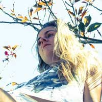 Photograph of Anna Dorn under a tree