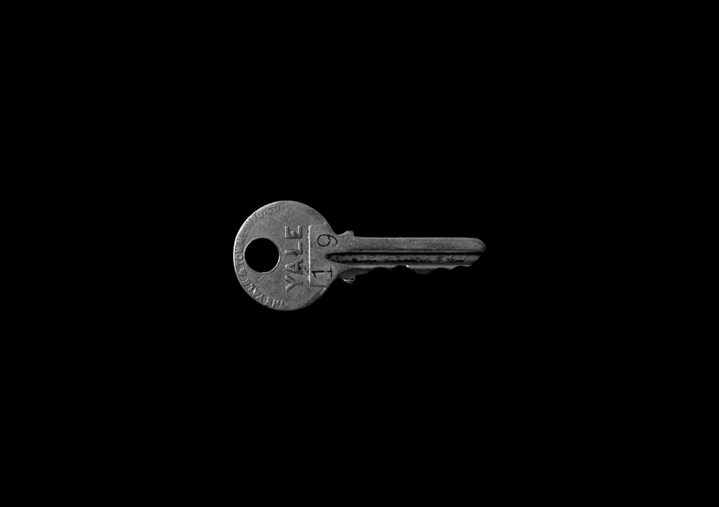 silver key on a black background