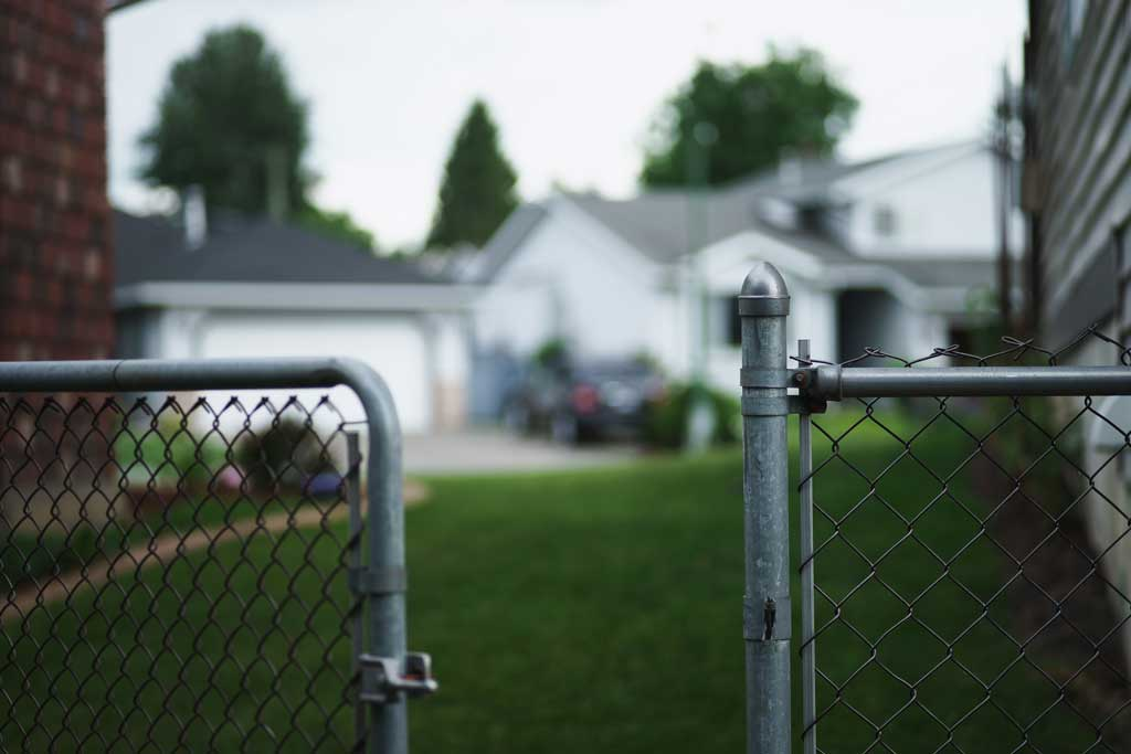 Photograph of open neighborhood fence