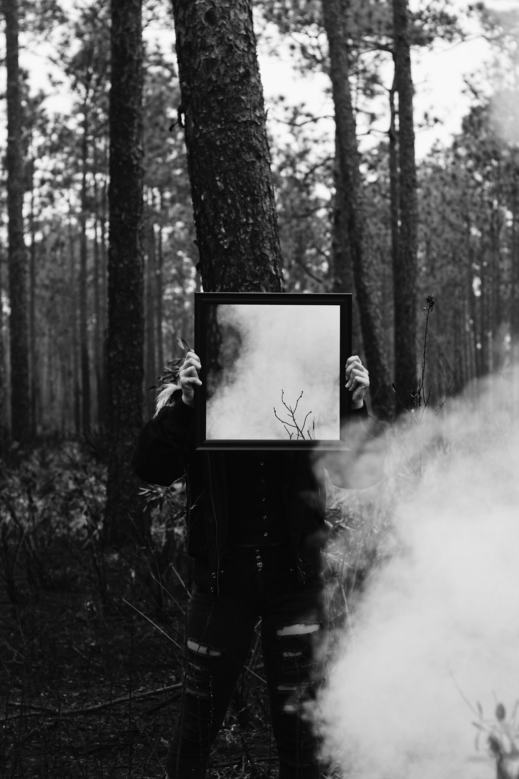 BW Person holding a mirror in the woods