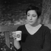 Rae Pagliarulo holding a cup of coffee