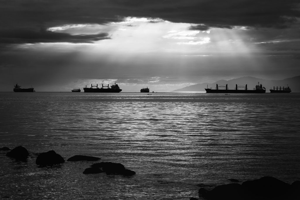 Ships on the horizon of the ocean