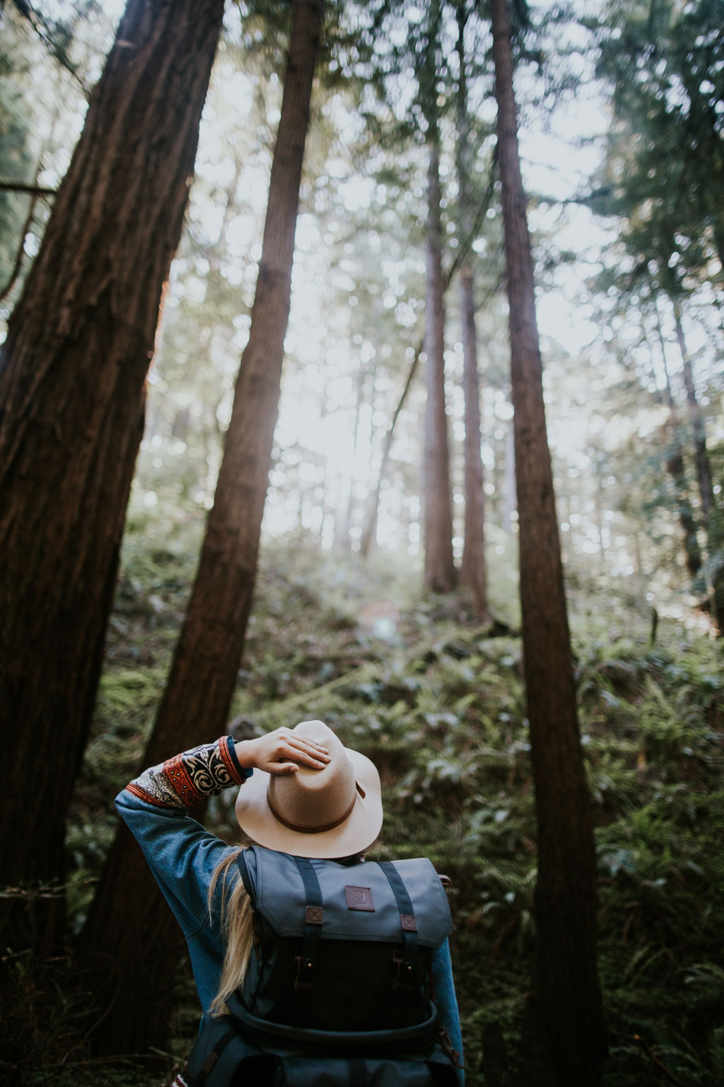 Woman Hiking in forest in California