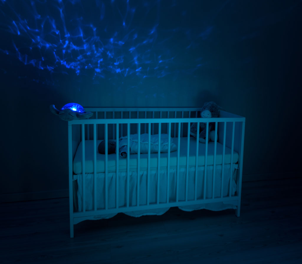 Baby crib in a darkened room