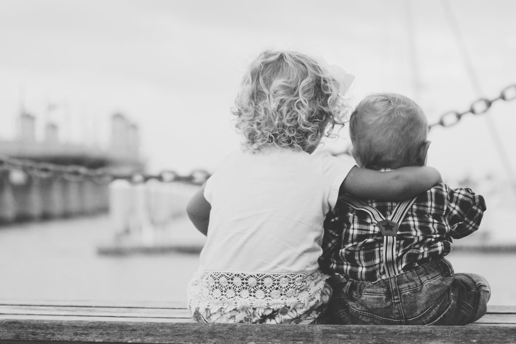 BW photo of two toddler-age children at water's edge
