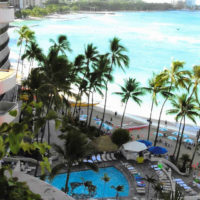 View of ocean, beach, palm trees in Waikiki from a high balcony
