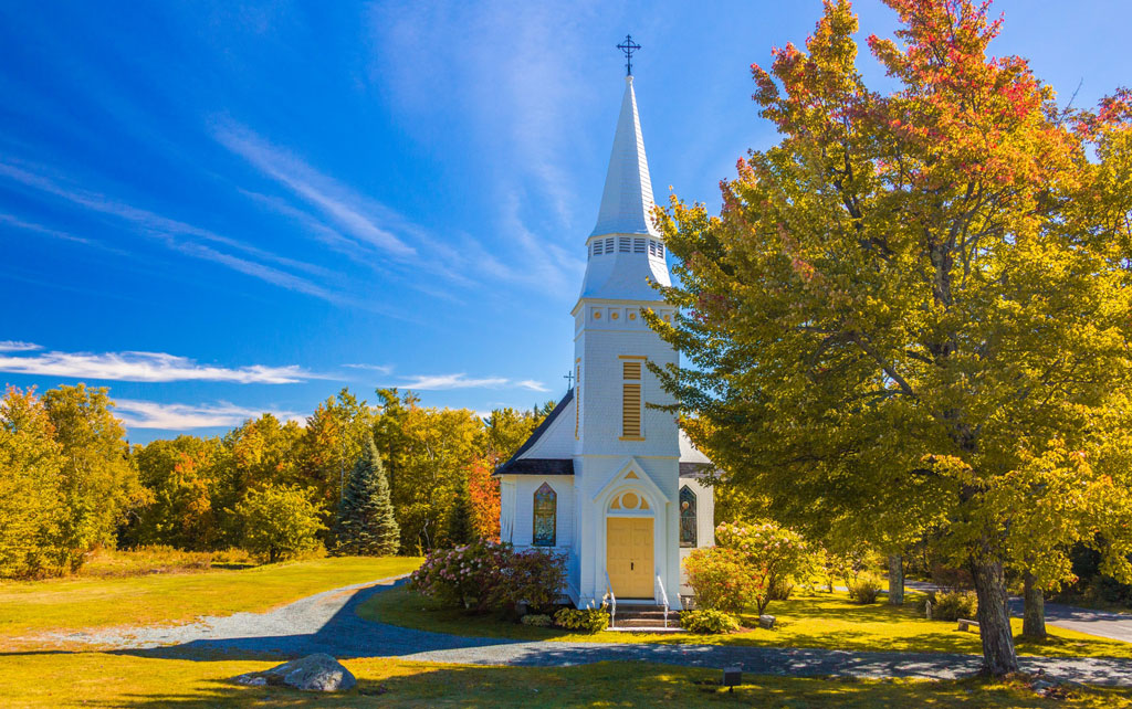 New England white church in autumn