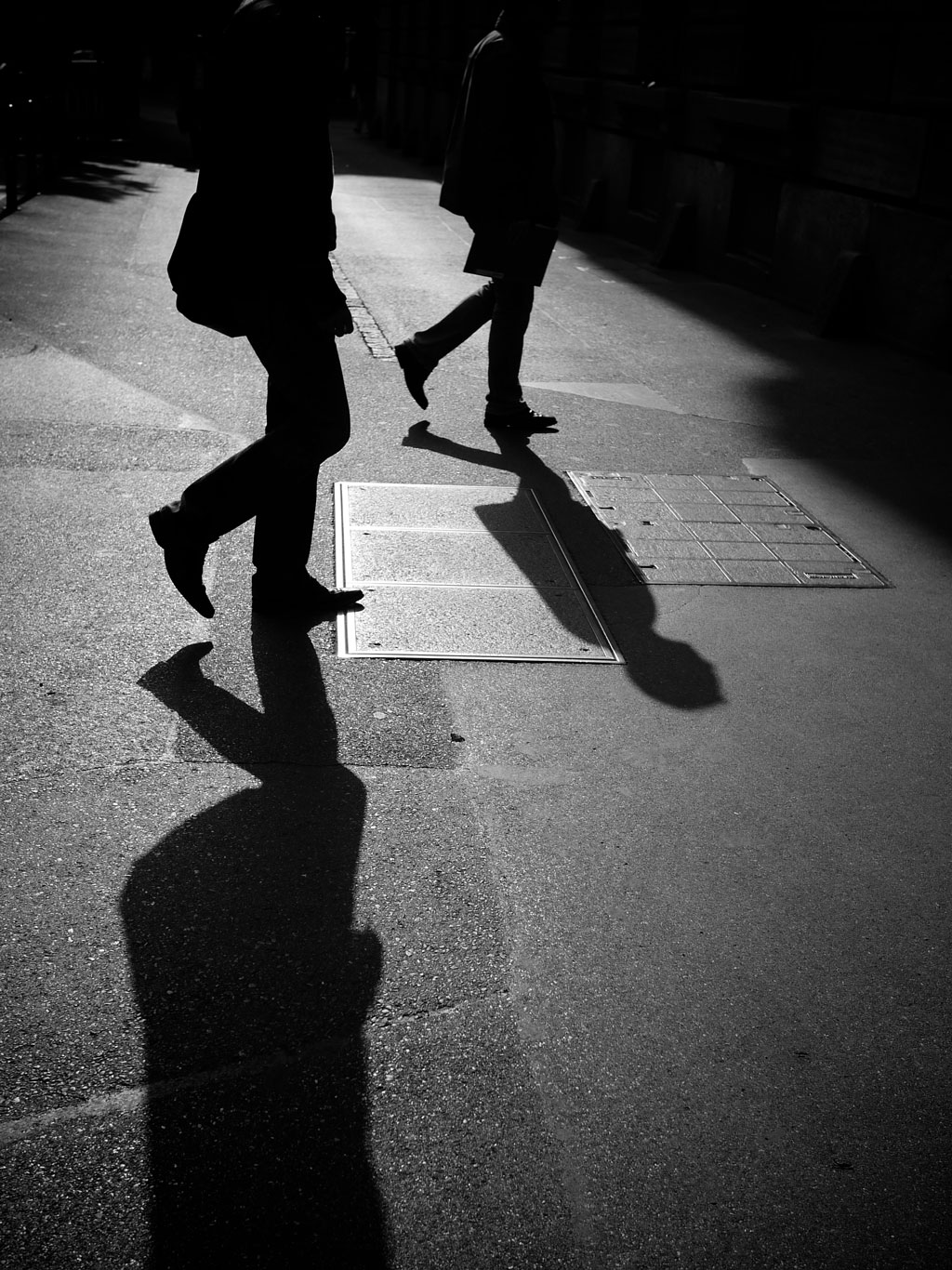 BW image of two figures with shadows