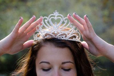 a beauty queen receiving her crown