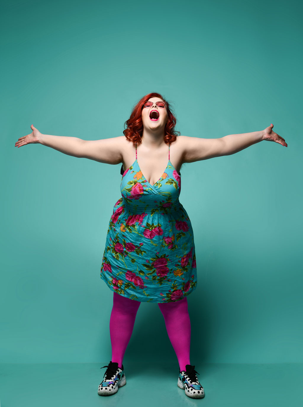 Woman singing with blue background