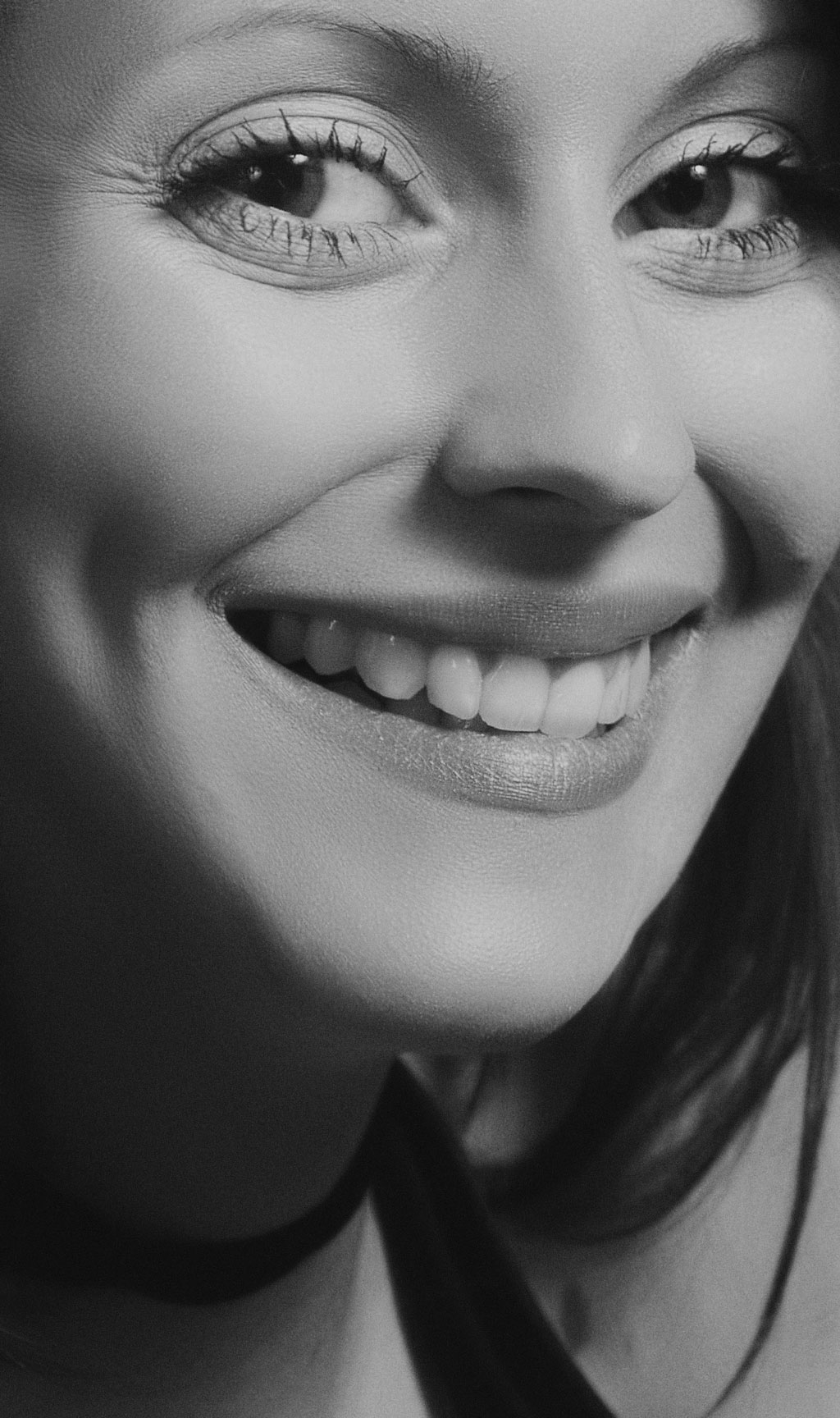woman smiling broadly
