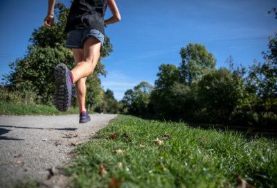 female runner on a sidewalk