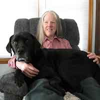 Donna W. Will author photo with guide dog