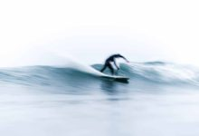 Long exposure shot of man surfing