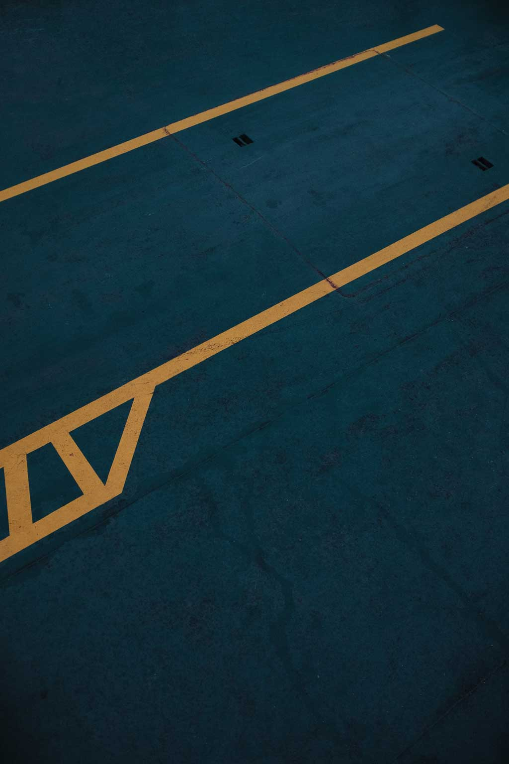 a parking lot space with yellow lines