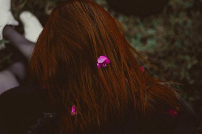 long hair with flower petals