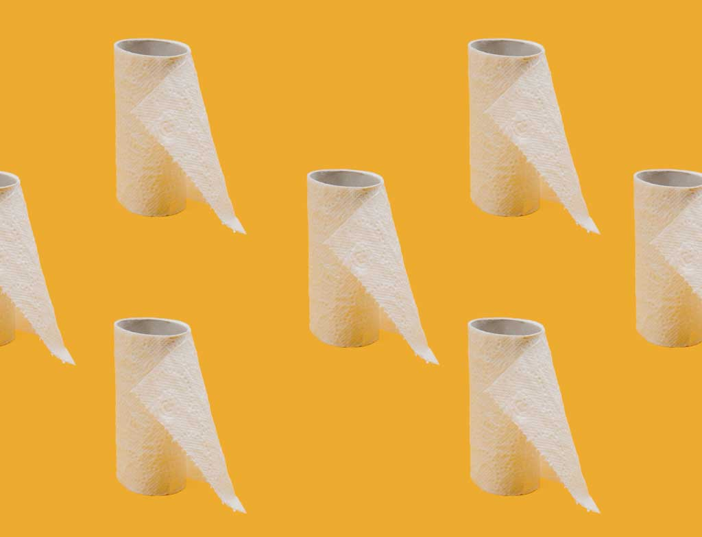 repeated image of empty toilet paper rolls against a yellow background