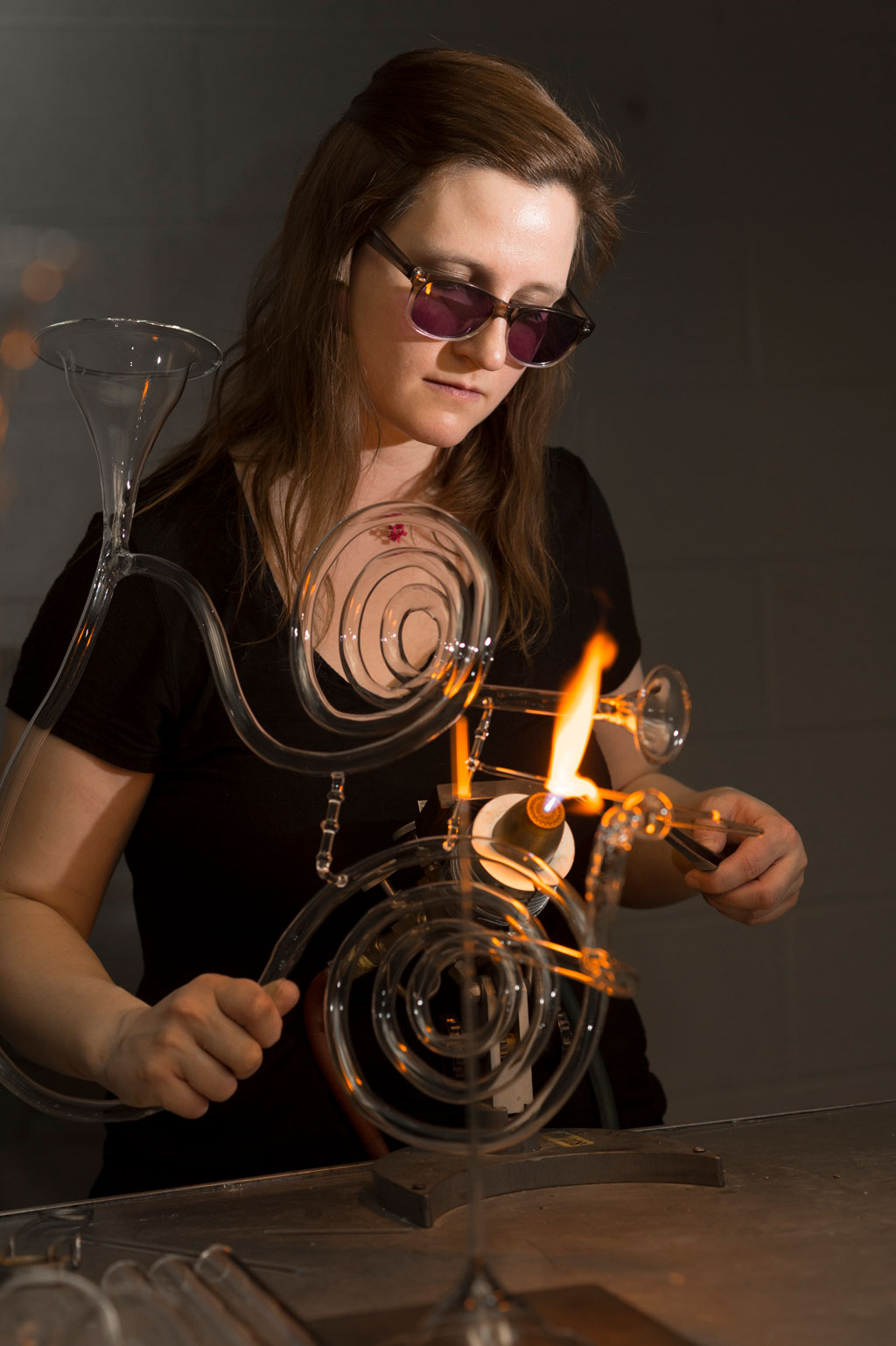 Madeline Rile Smith flameworking a glass instrument